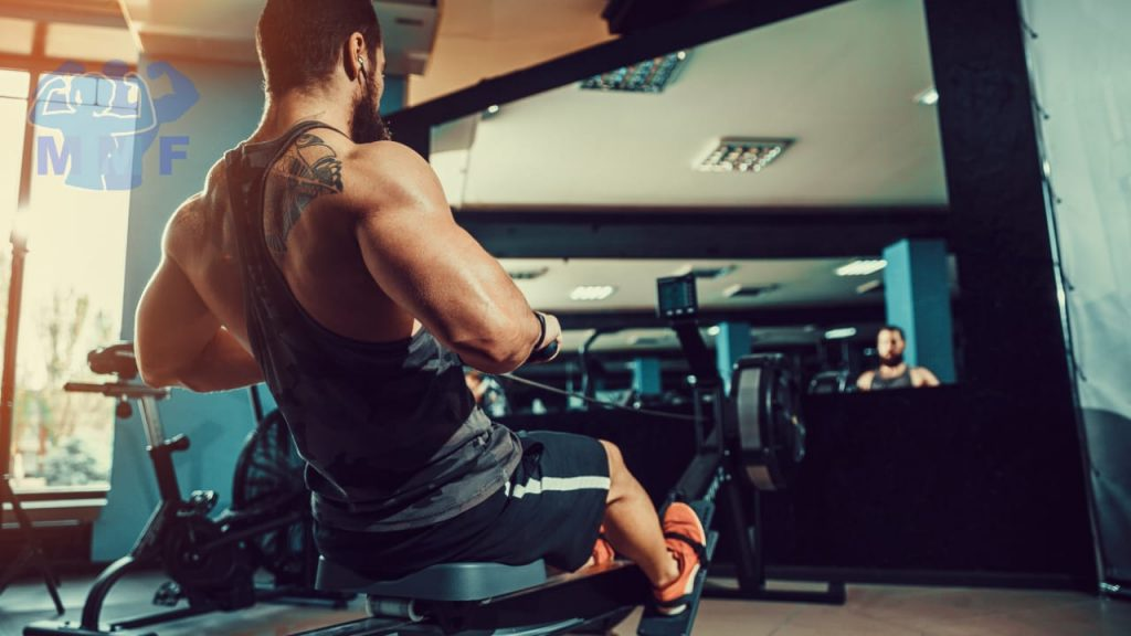 Strong man doing high-intensity interval cardio training on a rowing machine to burn fat fast