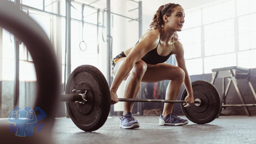 Fit Woman Performing Deadlifts As One Of The Best Weighted Core Exercises.