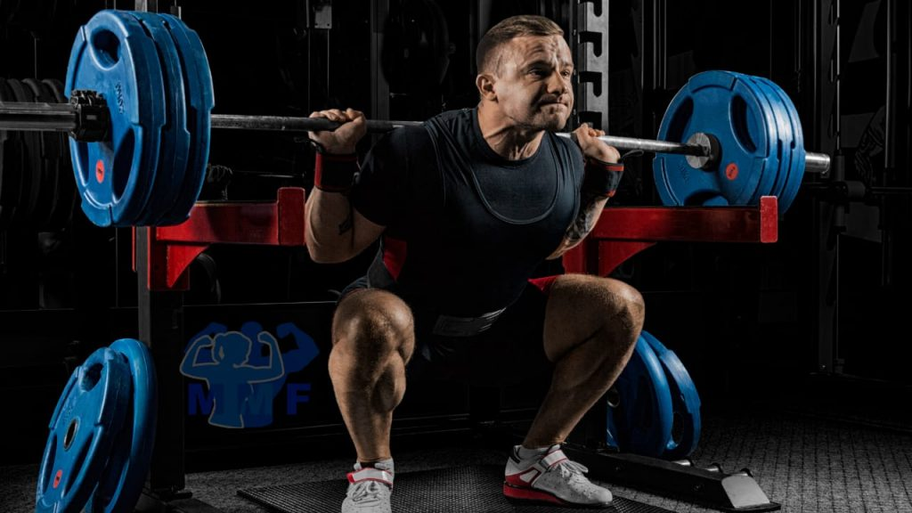 Fit Man Performing Good Barbell Squat Form