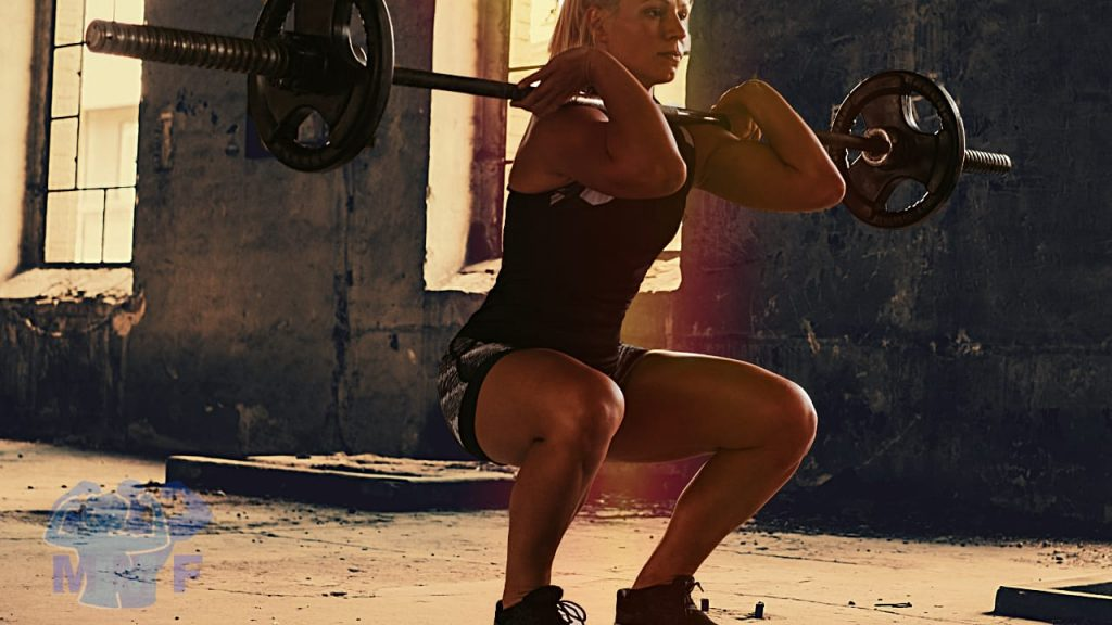 Fit Woman Performing Good Barbell Front Squat Form