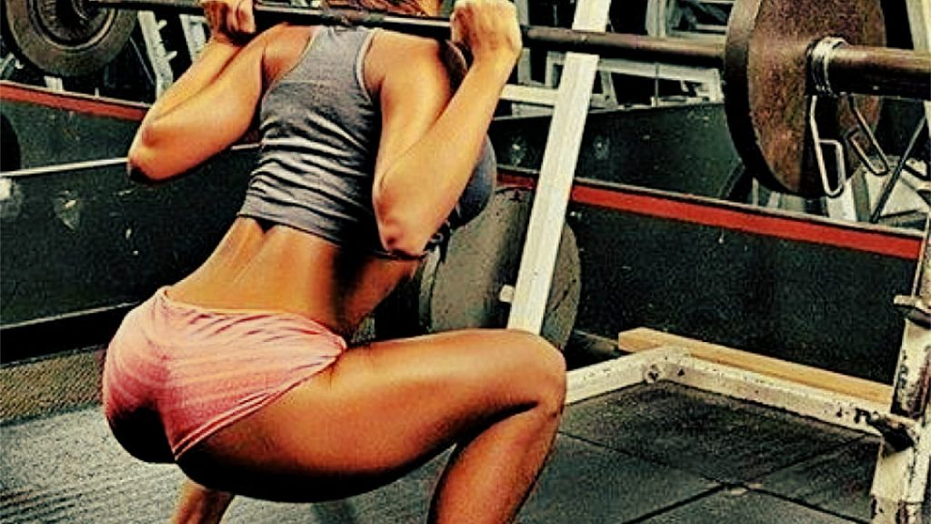 Fit woman with nice but peforming a glute isolation workout plan.