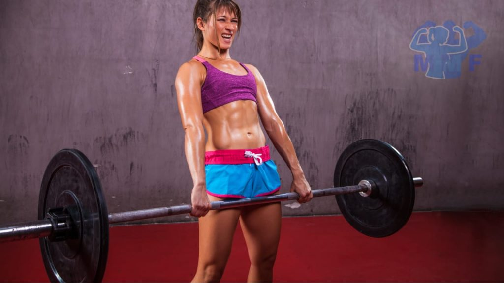 Hot strong woman deadlifting for training weight lifting for female beginners.