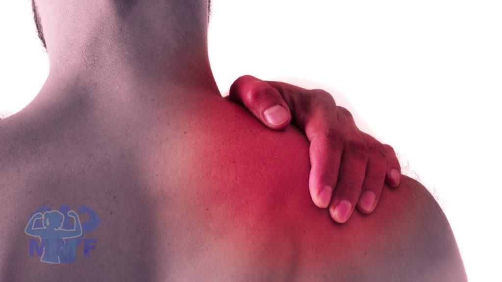 Man rubbing his red shoulder needing some rotator cuff exercises and stretches to prevent injuries.