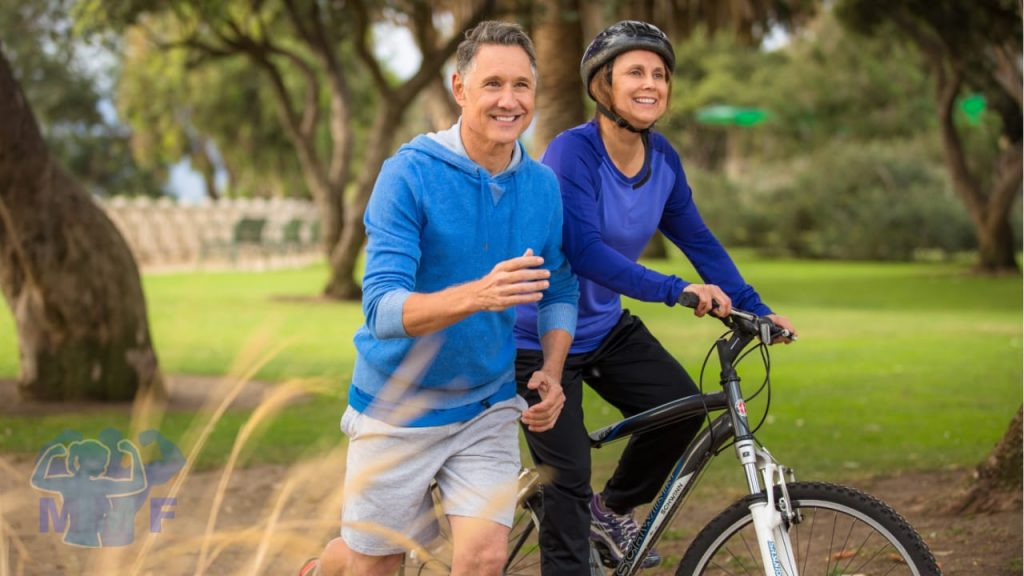 Elderly man running extending lifespan next to an elderly woman on a bike who both are very happy.