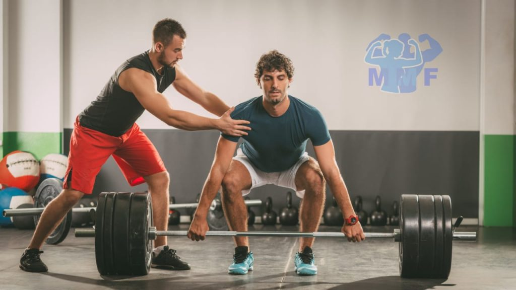 Bad Personal Trainer Trying to Help Client Deadlift.